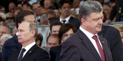 Petro Porosenko si Vladimir Putin constata ca armistitiul este